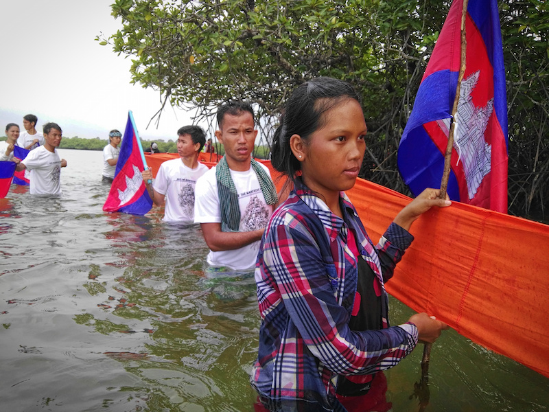 Villagers and activists take part in a blessing ceremony at Lovers Island in Koh Kong province on Monday. Activists say the island and others like it are disappearing due to sand dredging. (San Mala/Mother Nature)