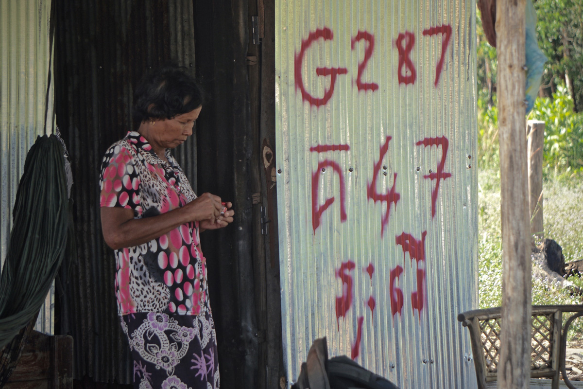 Chay Thou, 64, in front of her tin shack at the Kbal Chhay site. (Aisha Down/The Cambodia Daily)
