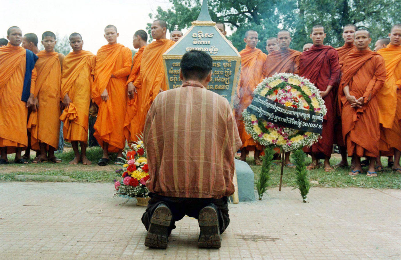 People gather at a memorial site on March 30, 1997